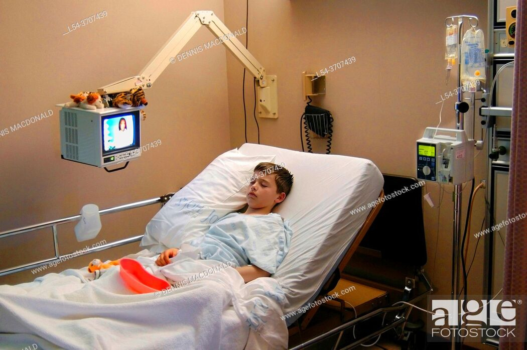 Stock Photo: 10 year old male child in a hospital bed.
