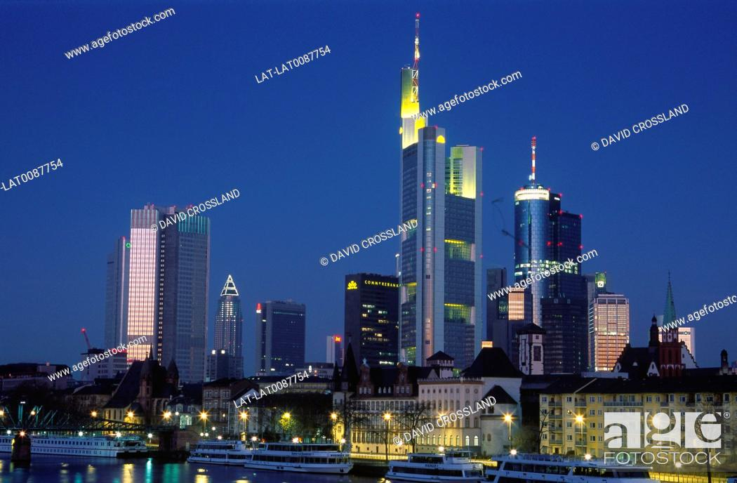 Stock Photo: Dawn. Skyline lit up. Modern buildings. Commerzbank,skyscrapers. River quay.