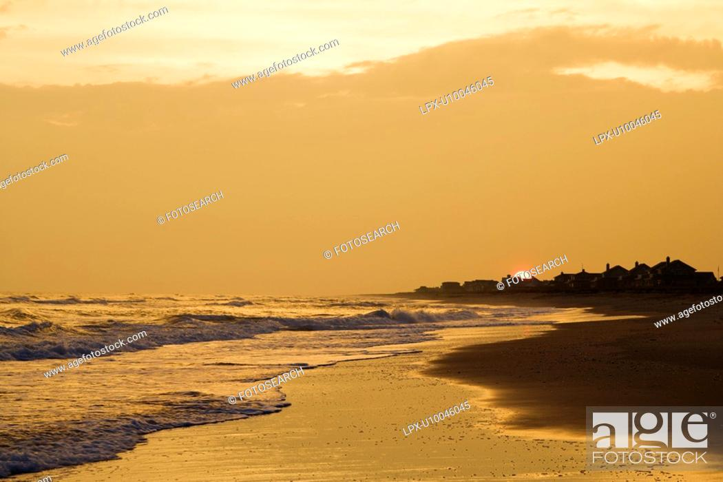 Stock Photo: Golden beach at sunset.