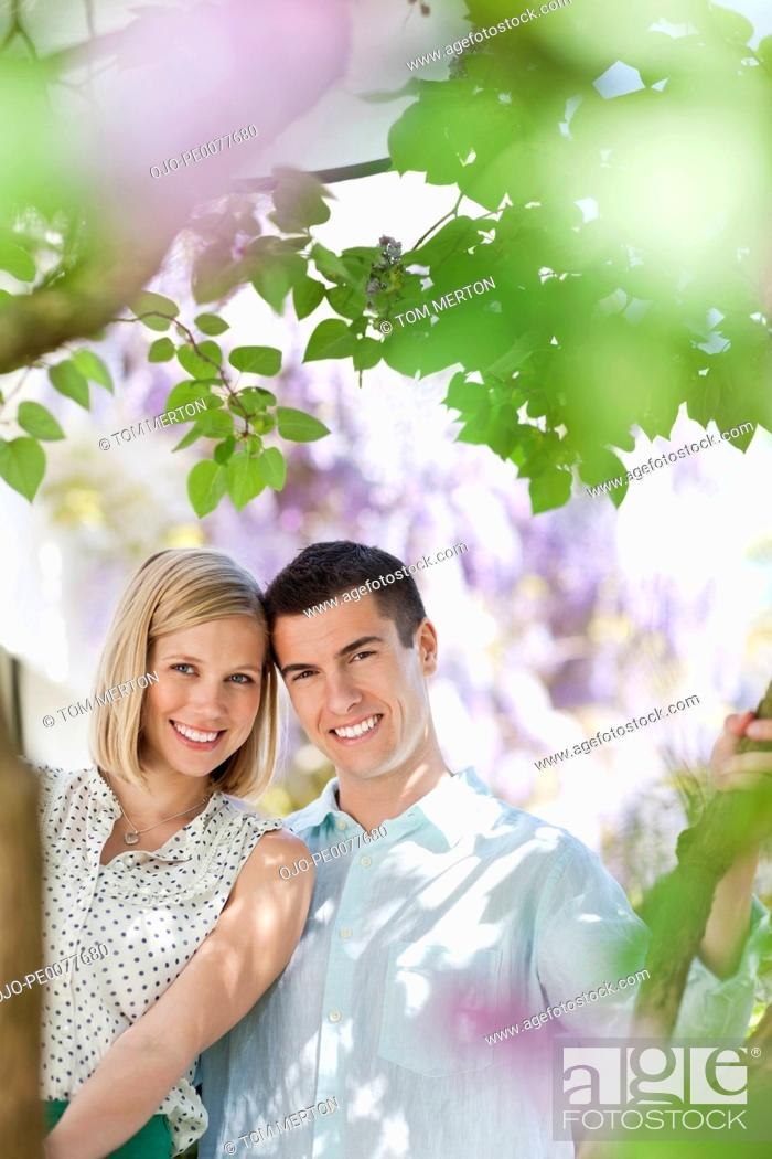 Stock Photo: Couple sitting together outdoors.