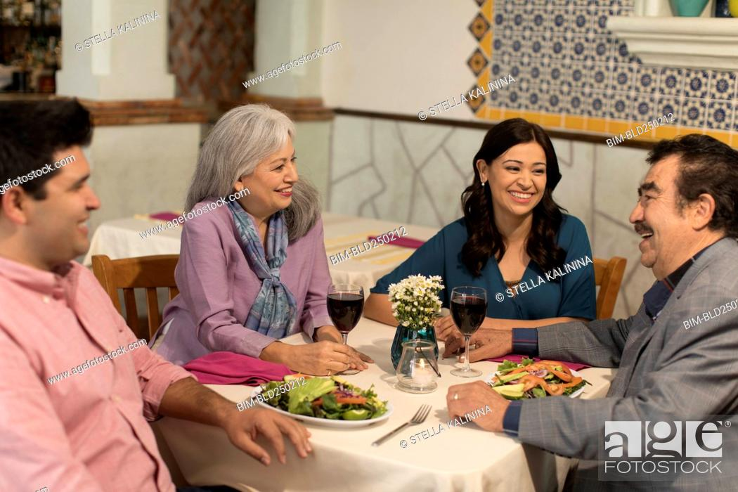 Stock Photo: Couples laughing in restaurant.