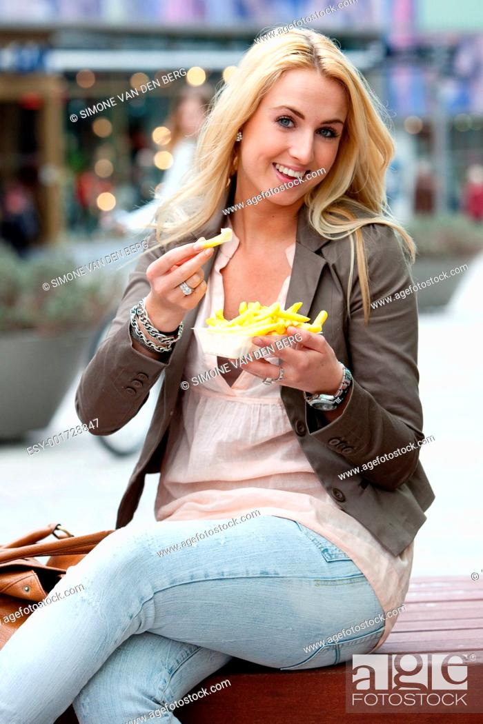 Stock Photo: eating fries.