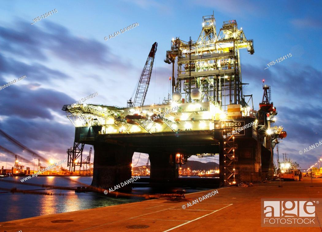 Stock Photo: Oil rig at sunset  Puerto de La Luz, Las Palmas, Gran Canaria.