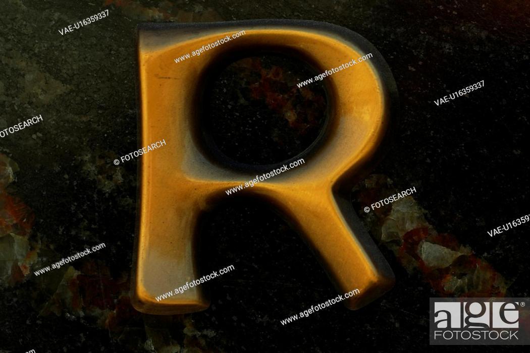 Stock Photo: shape, letter, stencil, formed, cut out, alphabet.