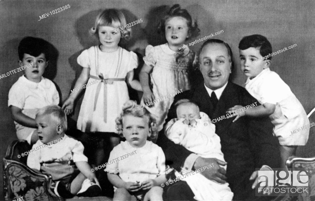 Stock Photo: Infante Juan Carlos of Spain (now King Juan Carlos) shown bottom left, looking out of the picture, appearing with his grandfather.