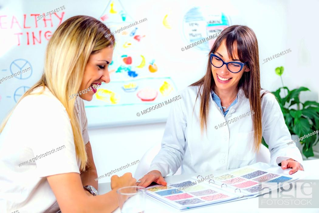 Stock Photo: Nutritionist with female patient.