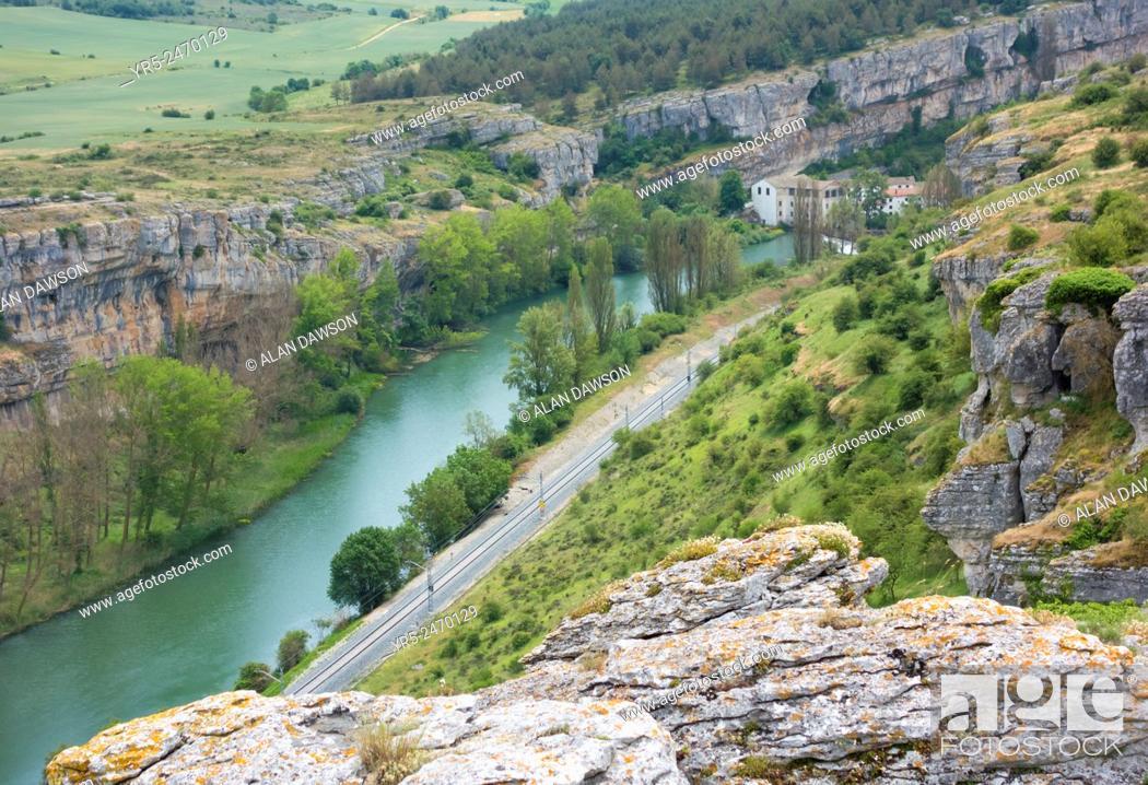 Stock Photo: View over La Horadada and Las Tuerces gorge with old flour mill and rail track alongside river Pisuerga. Palencia province, Castile and Leon, Spain.