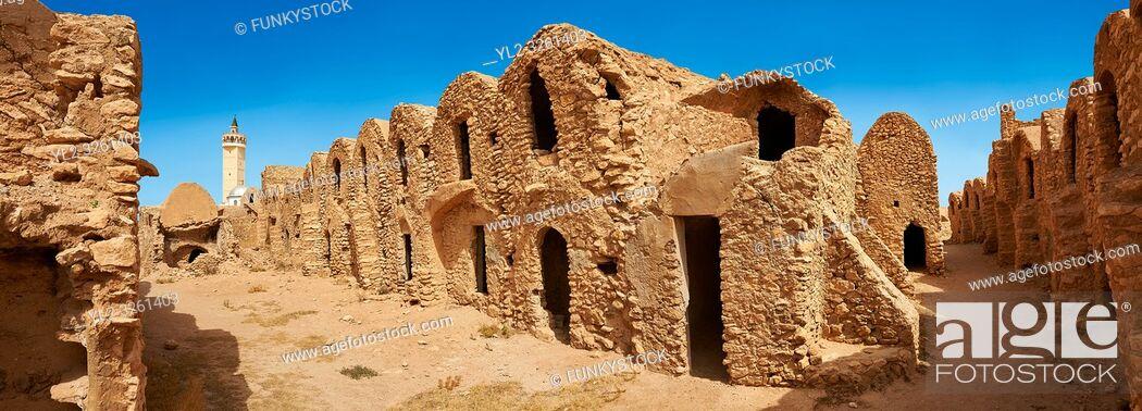 Stock Photo: The northern Sahara ghorfa storage graneries of the traditional Berber mud brick fortified Ksar of Hedada or Hadada, near Tetouin, Tunisia.