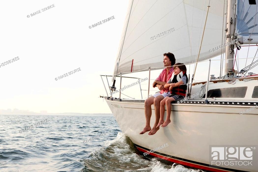 Stock Photo: Father and son sitting on yacht.