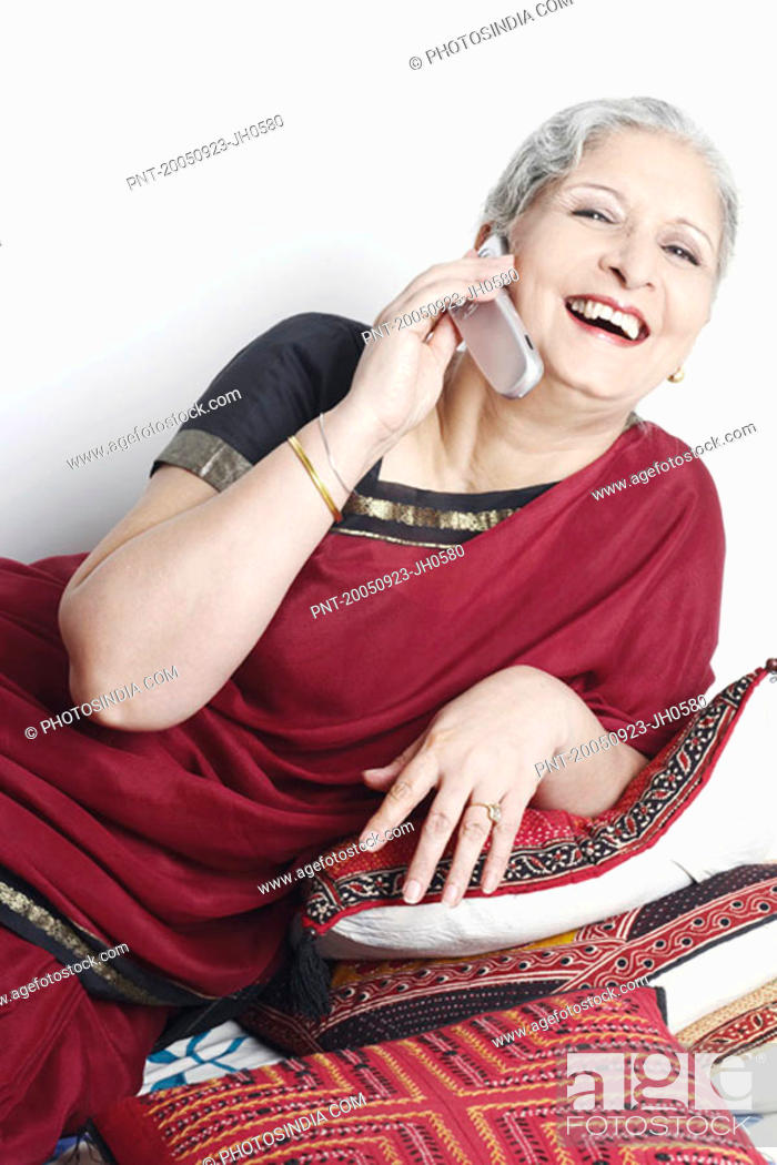 Stock Photo: Mature woman using a mobile phone.