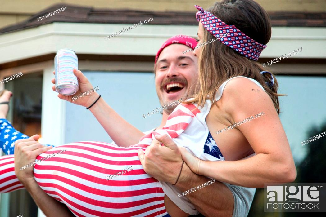 Stock Photo: Couple wearing American flag costume celebrating Independence Day, USA.