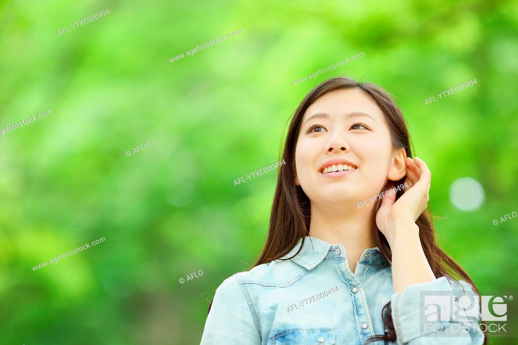 Stock Photo: Young Japanese woman in a city park.