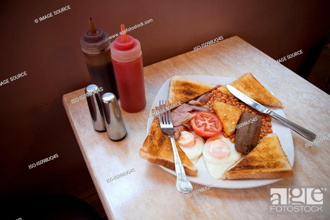 Stock Photo: English breakfast on a cafe table.