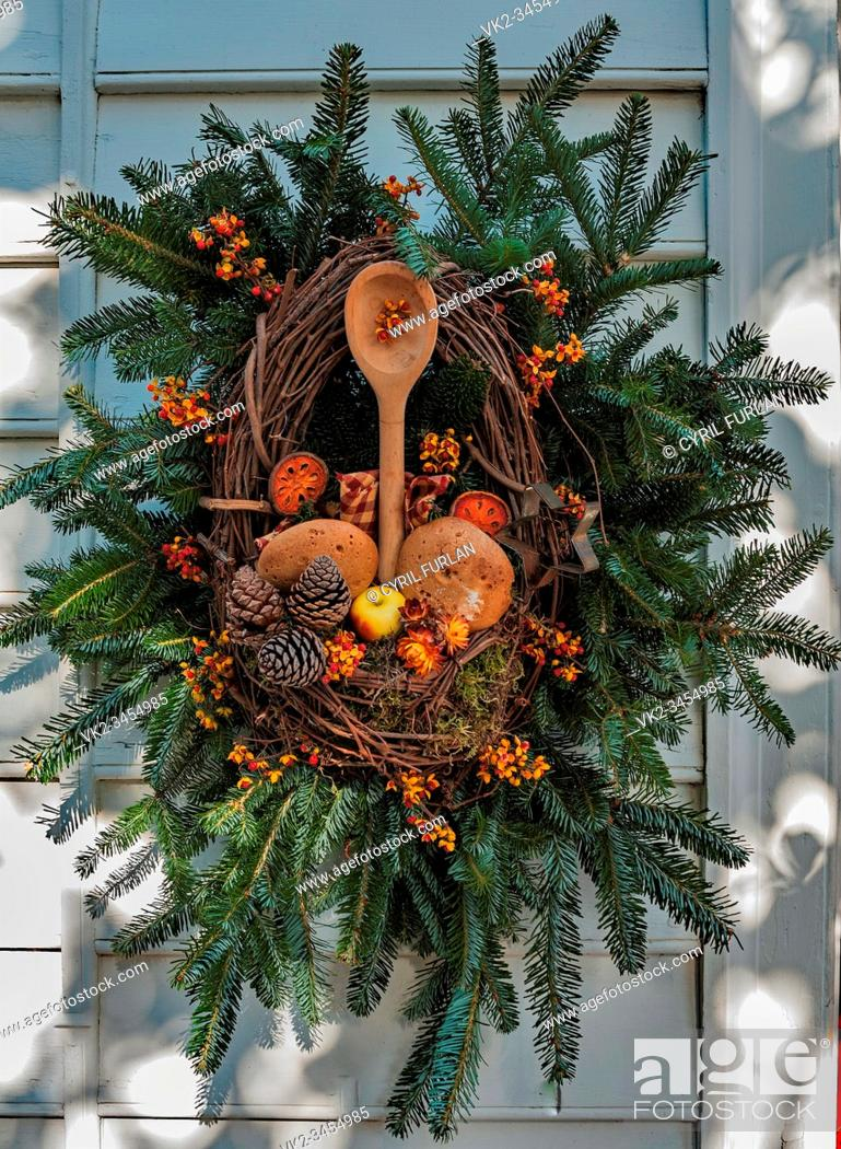 Stock Photo: Christmas decoration on the bakery in Colonial Williamsburg Virginia, wreath includes bakers wares and tools.