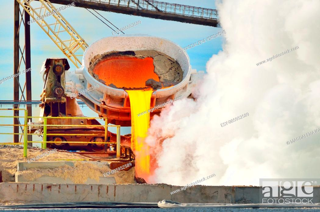 Stock Photo: hot steel pouring in steel plant. Production of cast iron in steel mills.