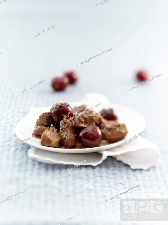 Stock Photo: Pan-fried lamb with cherries.