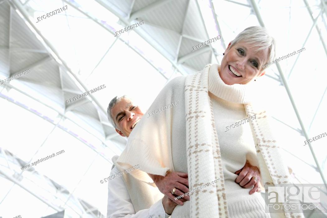 Stock Photo: Happy mature couple in airport.