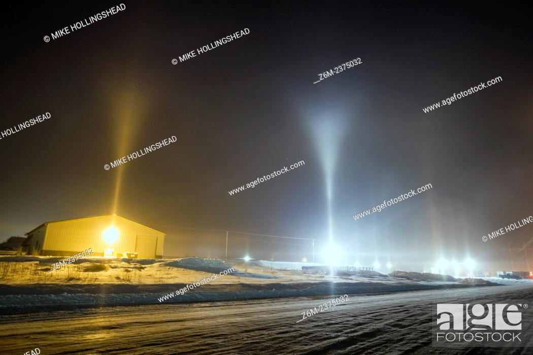 Stock Photo: Y-shape light pillars form in Blair Nebraska in freezing temps and from conditions related to steam production from a corn milliing plant.