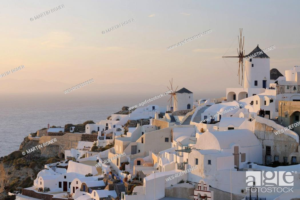 Stock Photo: Greece, View of Oia village with traditional Greek windmills at Santorini.