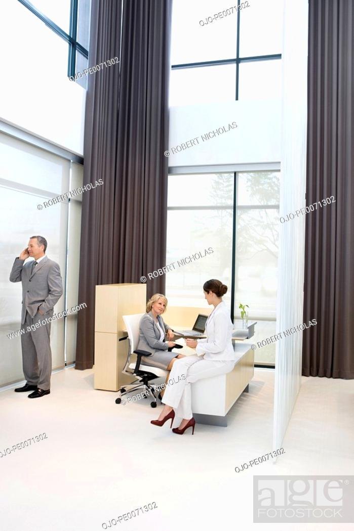 Stock Photo: Business people having meeting at desk.