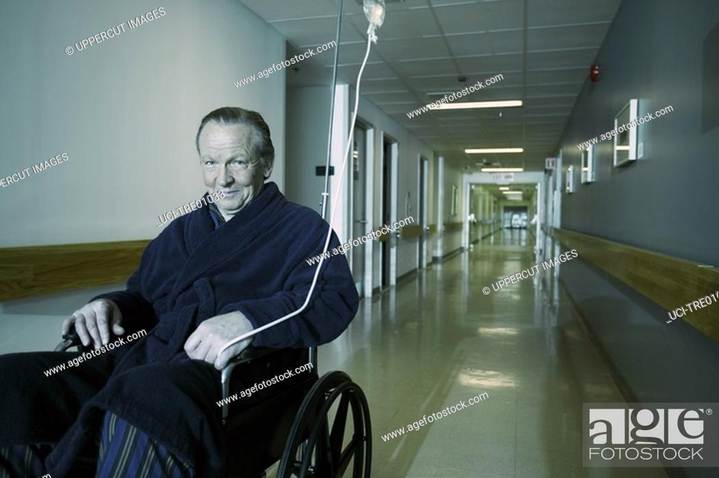 Stock Photo: Older man in hospital wheelchair.