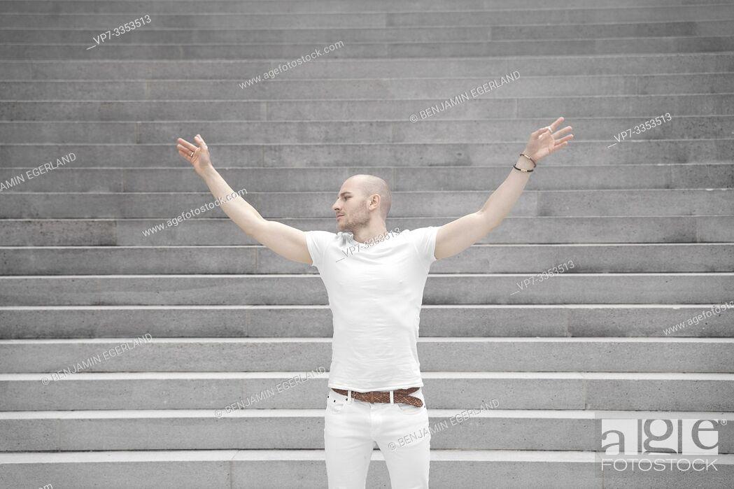 Stock Photo: carefree man balancing arms.