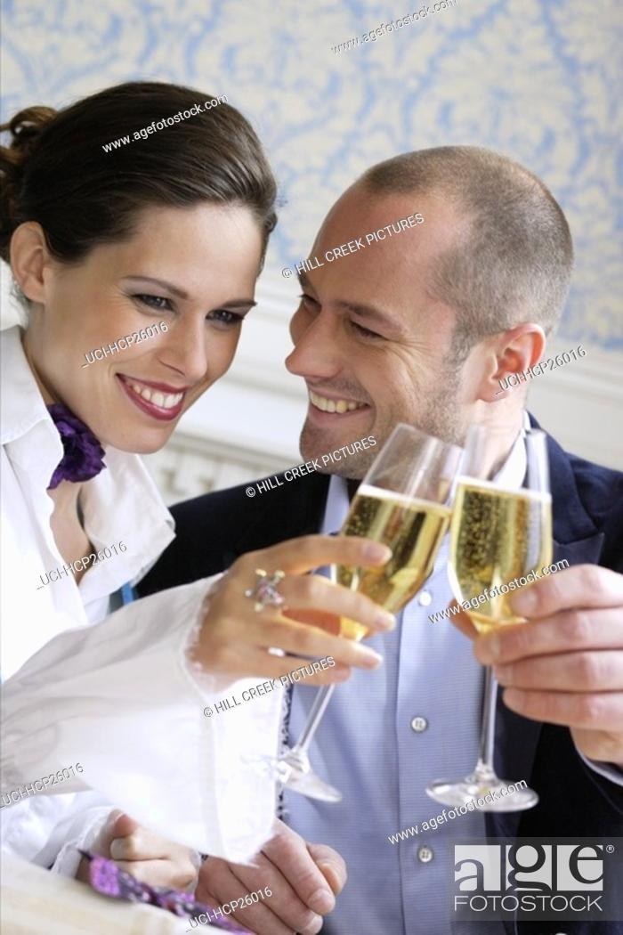 Stock Photo: Couple toasting each other with champagne.