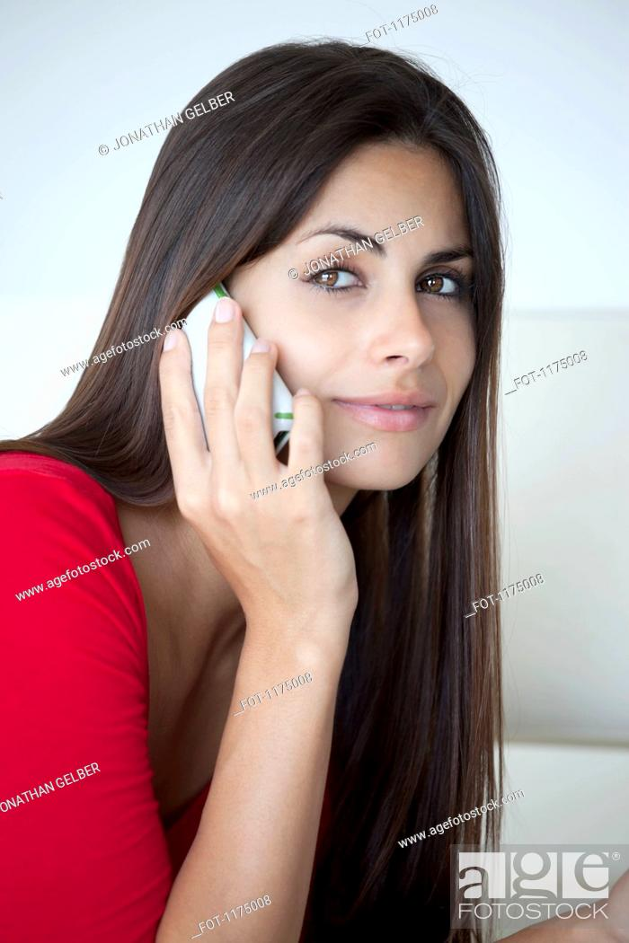 Stock Photo: Woman in red on phone.