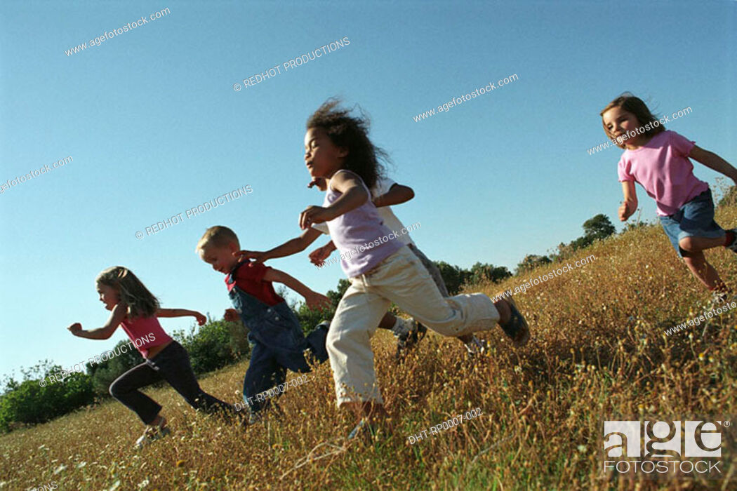 Stock Photo: Five children running in field.