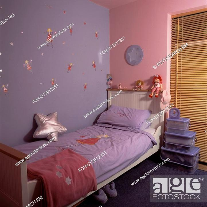 Stock Photo Mauve And Pink Walls Above White Bed With Bedlinen In Economy Style Child S Bedroom Plastic Storage Bo