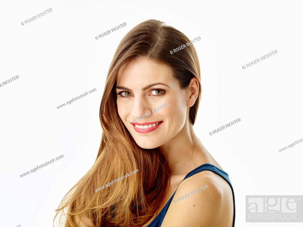 Stock Photo: Portrait of smiling woman with long hair against white background.