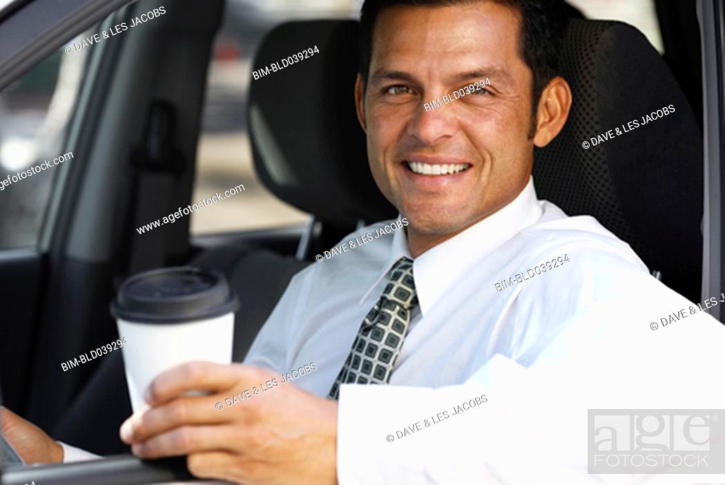 Stock Photo: Hispanic businessman in car.