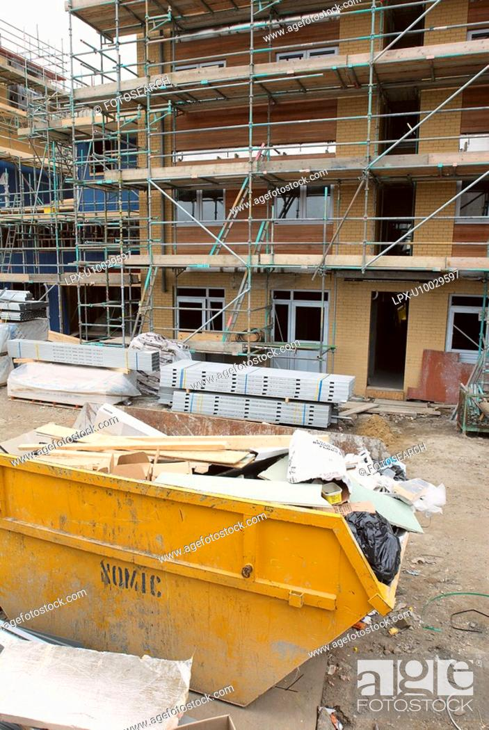 Stock Photo: Overloaded skip on a building site - waste segregation.