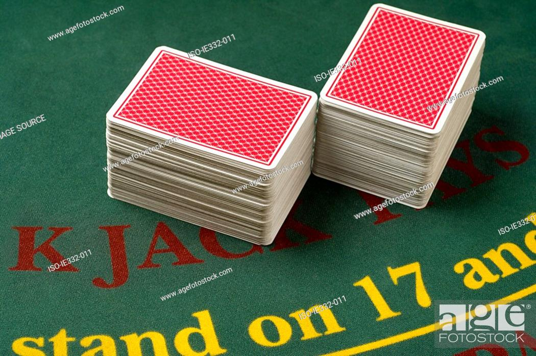 Stock Photo: Stacked playing cards in a casino.