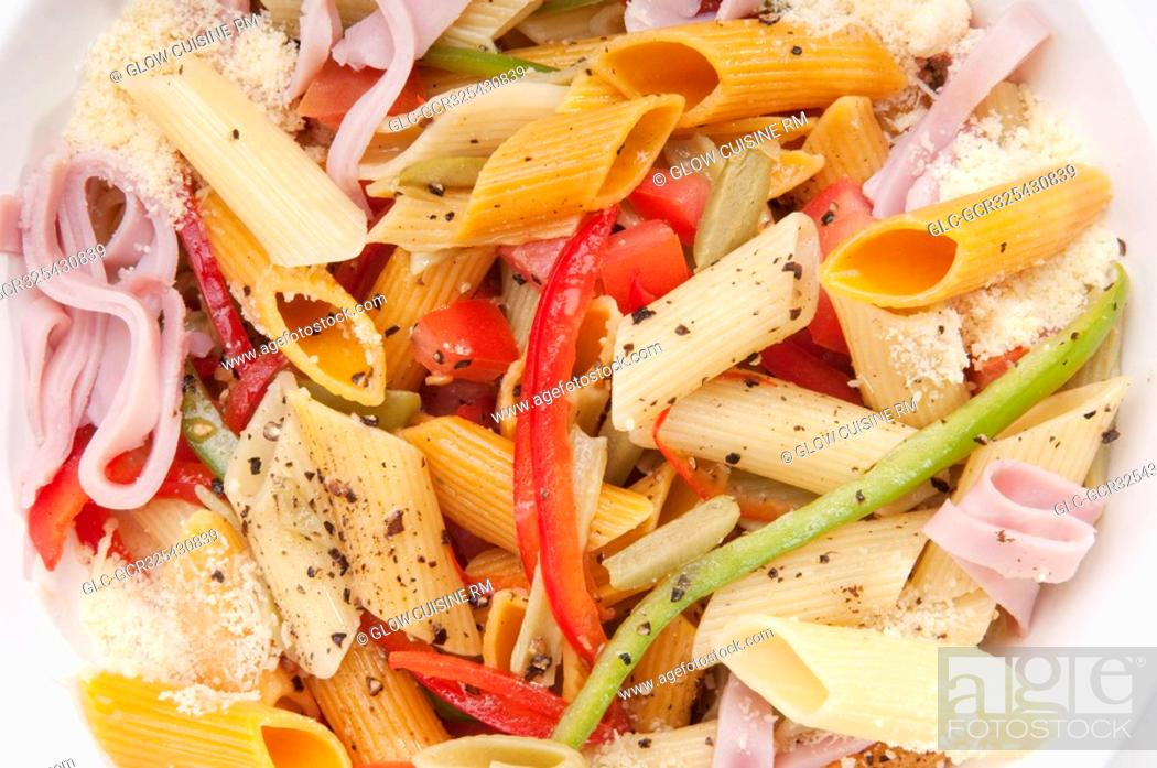 Stock Photo: High angle view of a bowl of penne pasta and ham salad.
