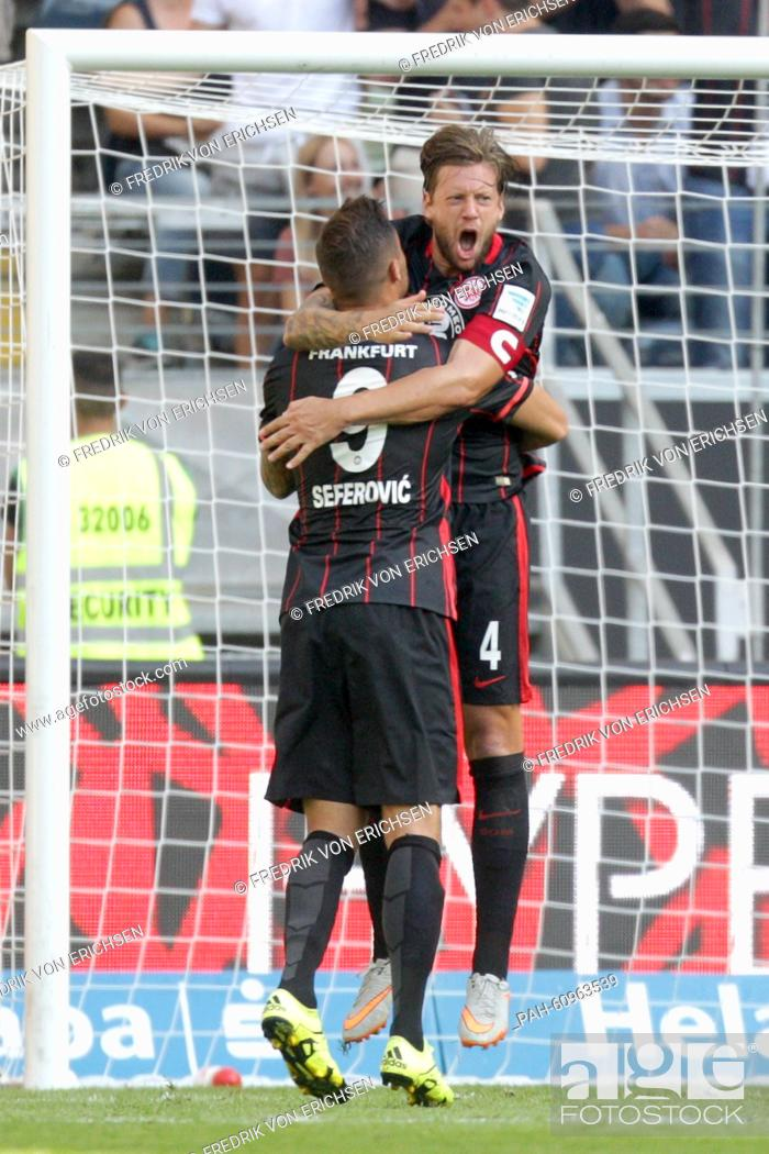Stock Photo: Frankfurt's Marco Russ (r) celebrates his goal 1:1 with Haris Seferovic during the game between Eintracht Frankfurt and FC Augsburg in the Commerzbank Arena in.