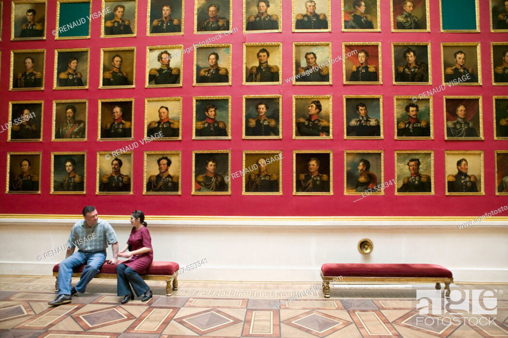 Stock Photo: Couple seated in front of portrait gallery of the portrait gallery of the 1812 war heroes in the Hermitage Museum (Winter Palace). St Petersburg.