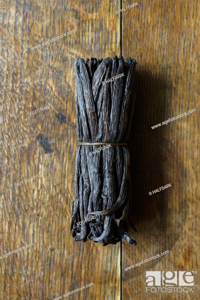 Stock Photo: Directly above shot of vanilla pods in bunch on table.