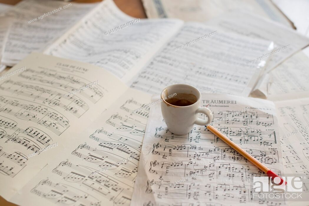 Stock Photo: Strong coffee and music score on musicians desk.