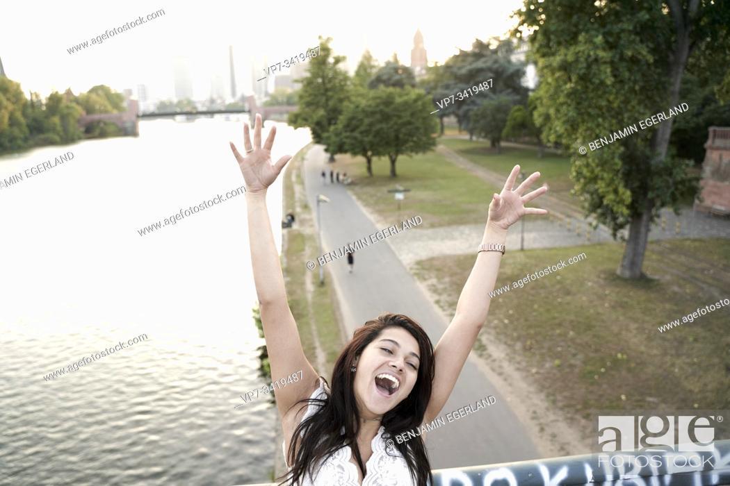 Stock Photo: Portrait of happy young woman, Frankfurt am Main, Germany.