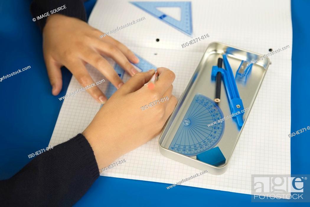 Stock Photo: Student doing geometry.