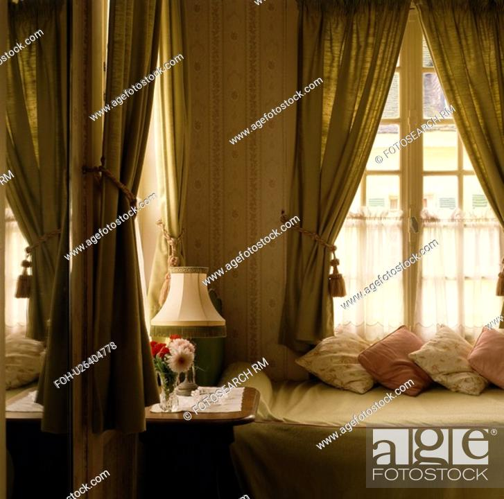 Stock Photo Beige Curtains With Net Curtain On Window Above Single Bed In Neutral Bedroom