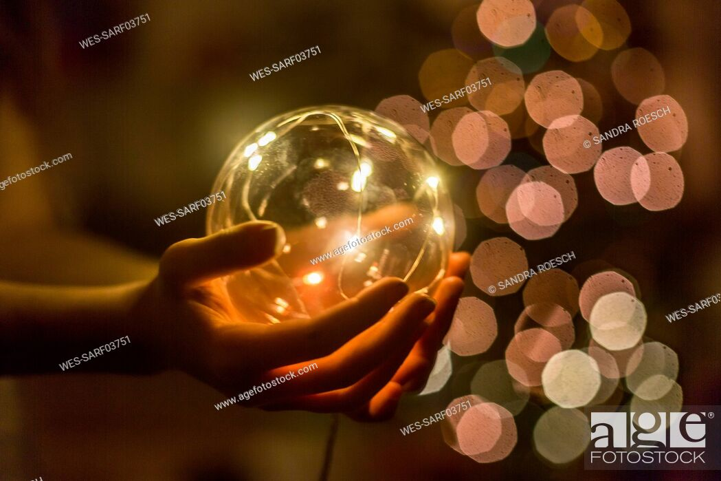 Stock Photo: Hands of girl holding shining crystal ball.