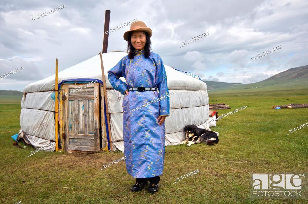 Stock Photo: Woman in front of a yurt. Mongolia, Khovsgol, Zuun Nuur lake. Model Released. (/Julien Garcia).