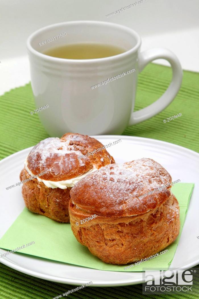 Stock Photo: Two profiteroles and tea.