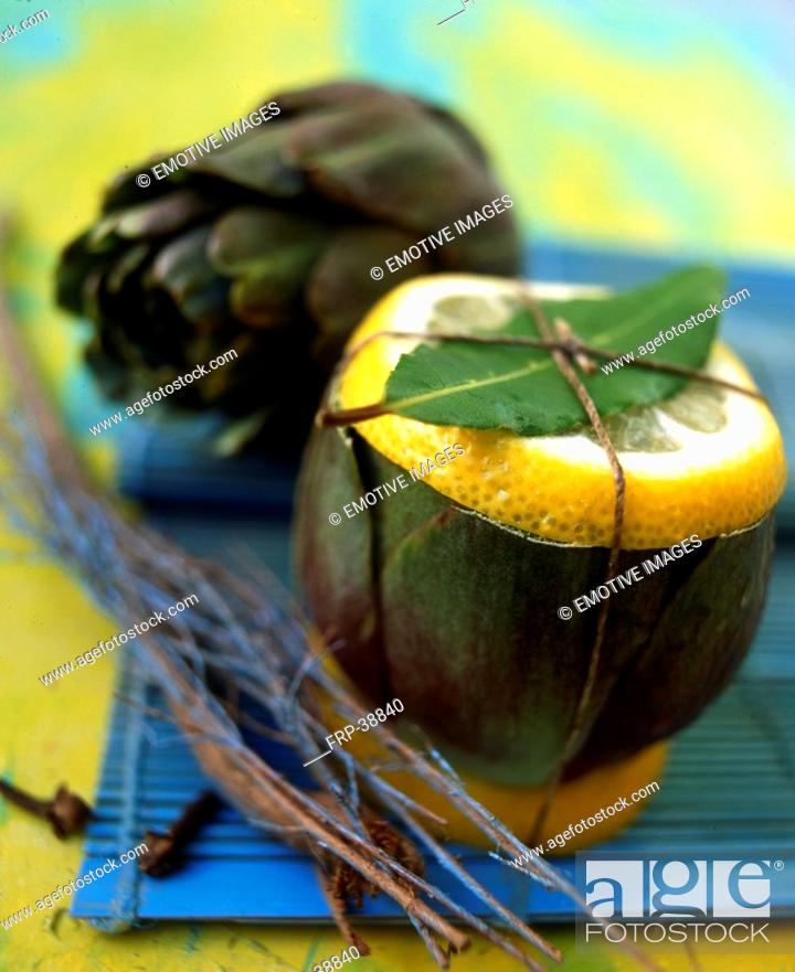 Stock Photo: Artichoke with lemon.