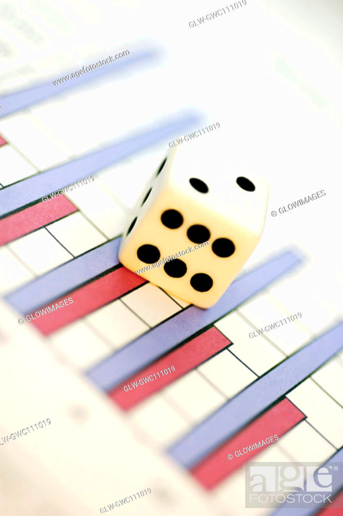 Stock Photo: Close-up of a dice on a bargraph.
