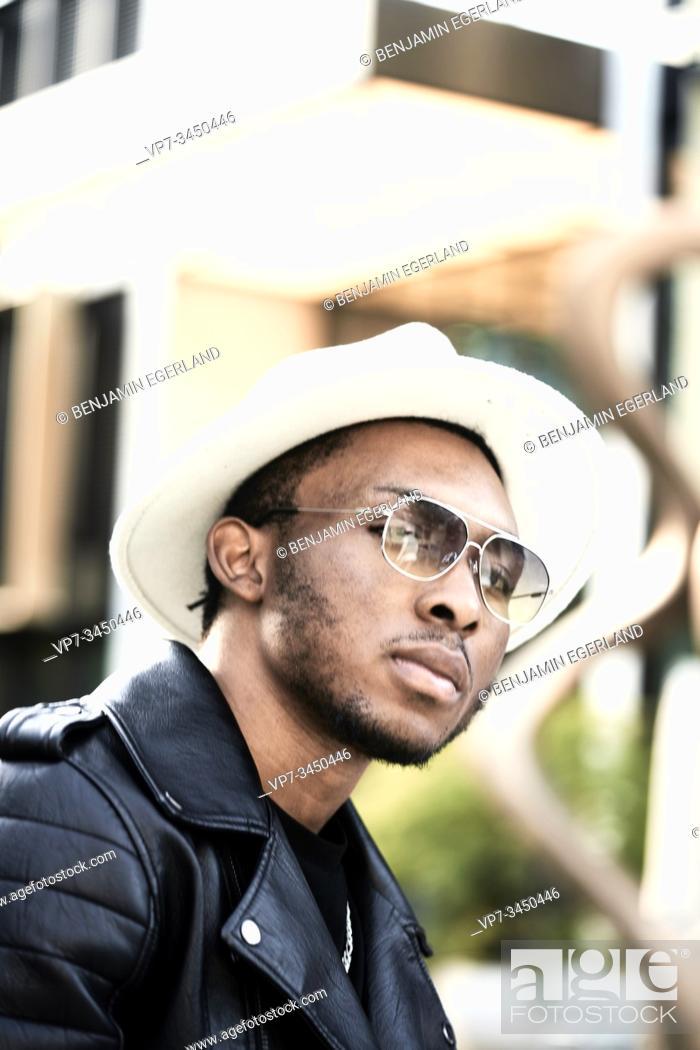 Stock Photo: Portrait of man wearing hat. Munich, Germany.