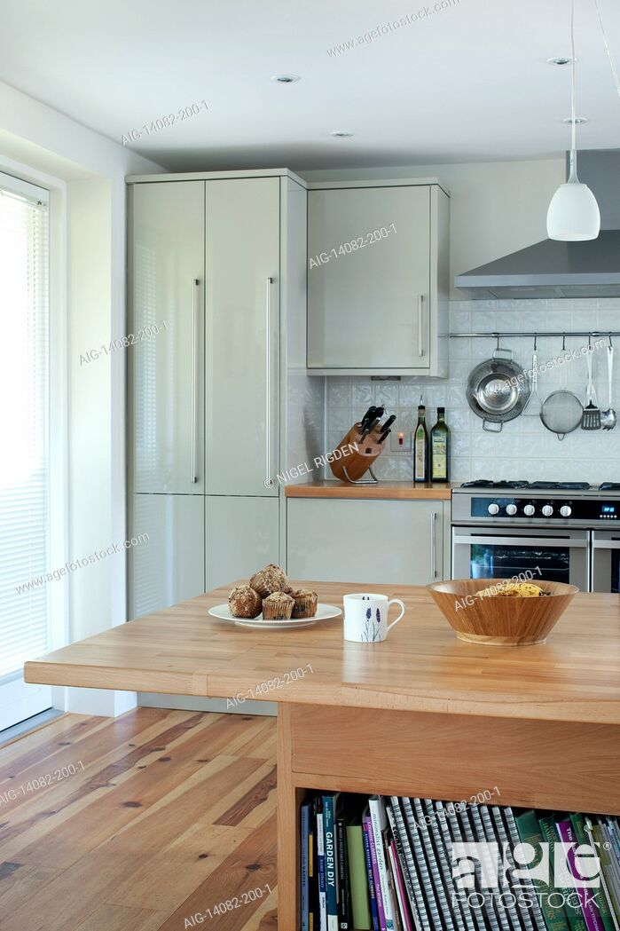 Stock Photo: Looking across the end of the dining room table to the kitchen, UK.