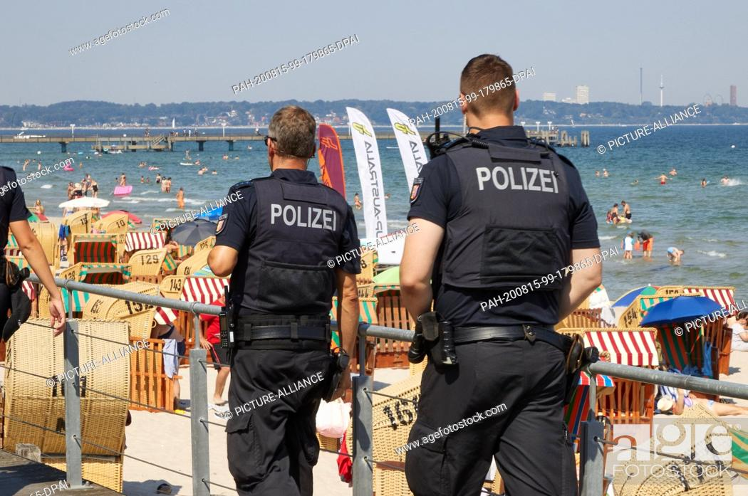 Stock Photo: 15 August 2020, Schleswig-Holstein, Scharbeutz: Police patrol the Baltic Sea beach in Scharbeutz. Photo: Georg Wendt/dpa.